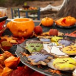 Halloween cookies on a festive outdoor table.